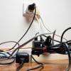 Messy wires behind tv hero