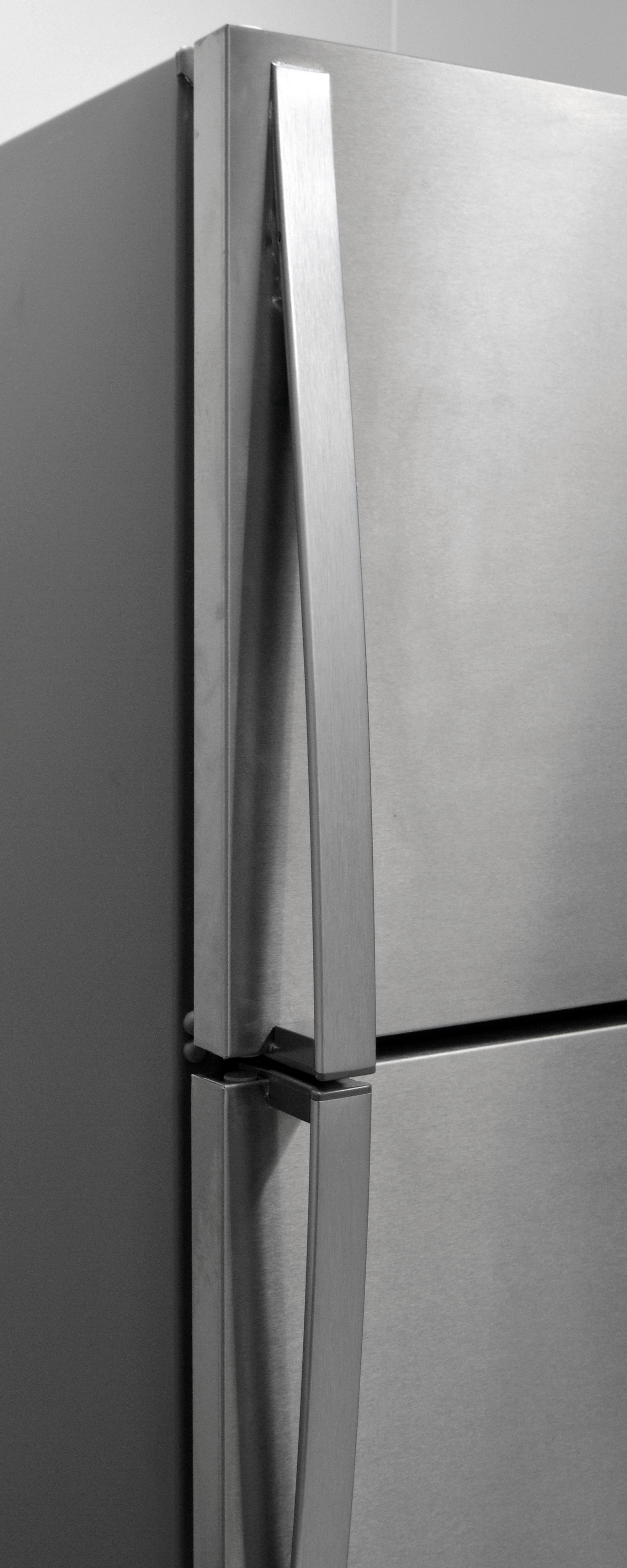 The Whirlpool WRT311FZDM's metallic handles look and feel nice against the stainless exterior.