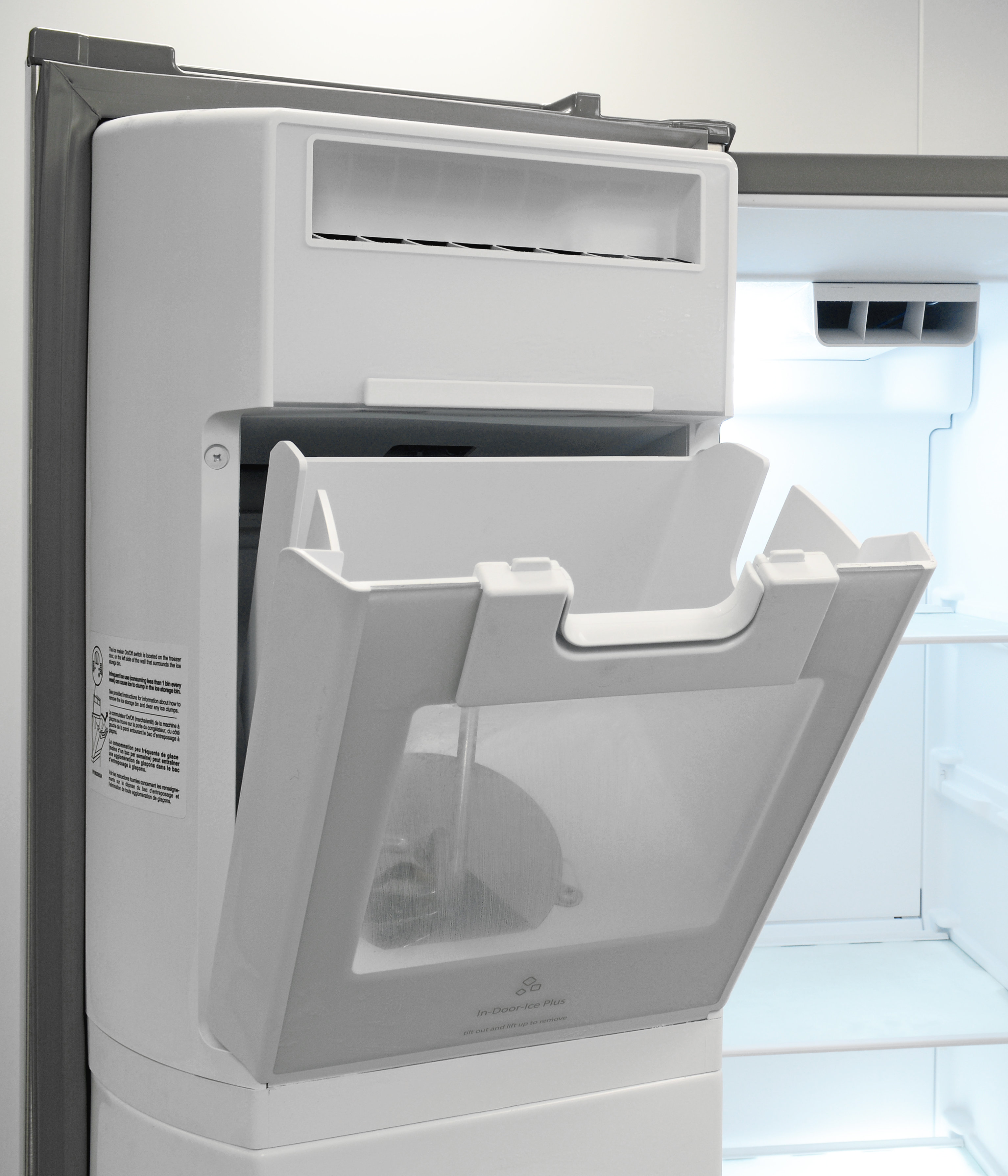 The Whirlpool WRS571CIDM's door-mounted icemaker tilts forward for easy cube access.