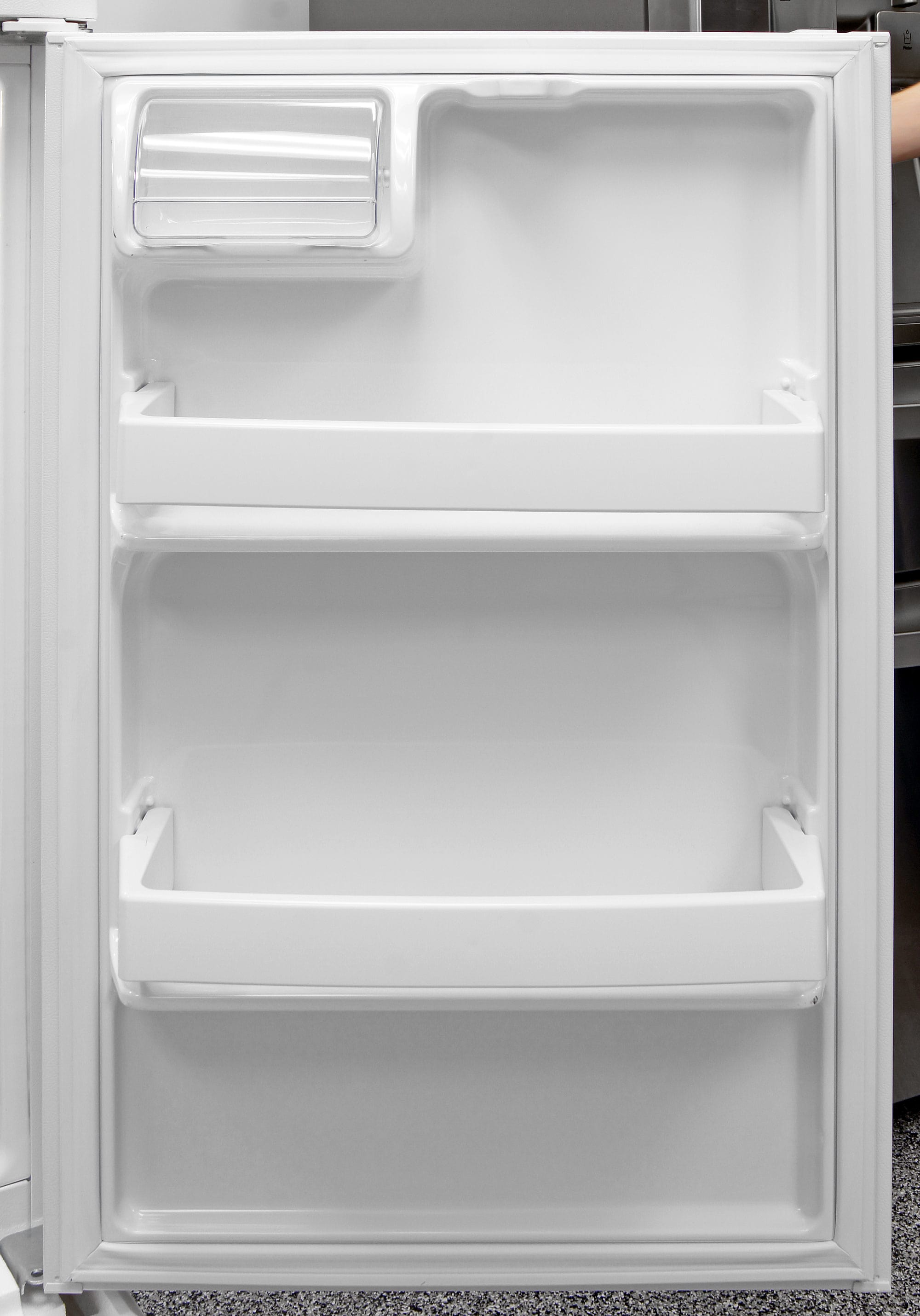 You can't adjust any of the shelves on the GE GTS16DTHWW's fridge door, but they offer a variety of heights and enough depth to fit a gallon jug.