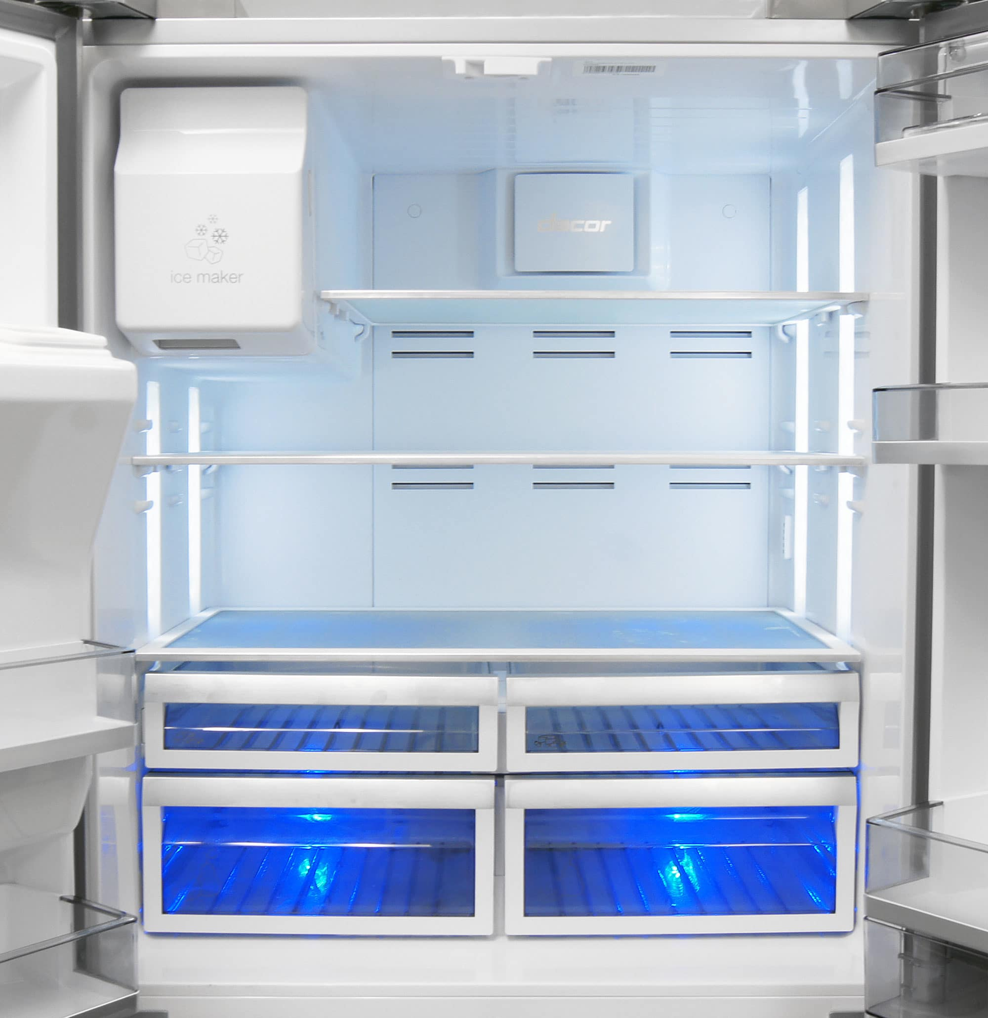 The interior looks great, but you don't normally see unadjustable, full-width shelves in a high-end fridge like the Dacor DTF364SIWS.
