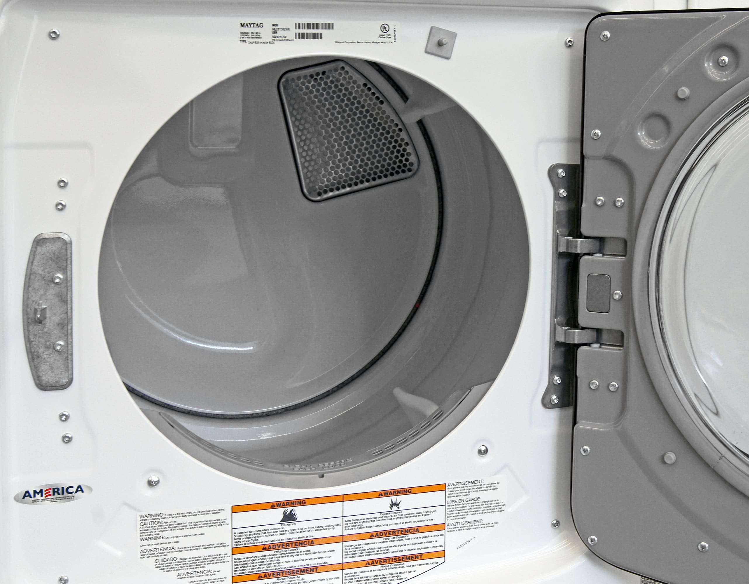 On the inside, you find a white plastic drum—unsurprising for a low-cost dryer like the Maytag Maxima MED3100DW.
