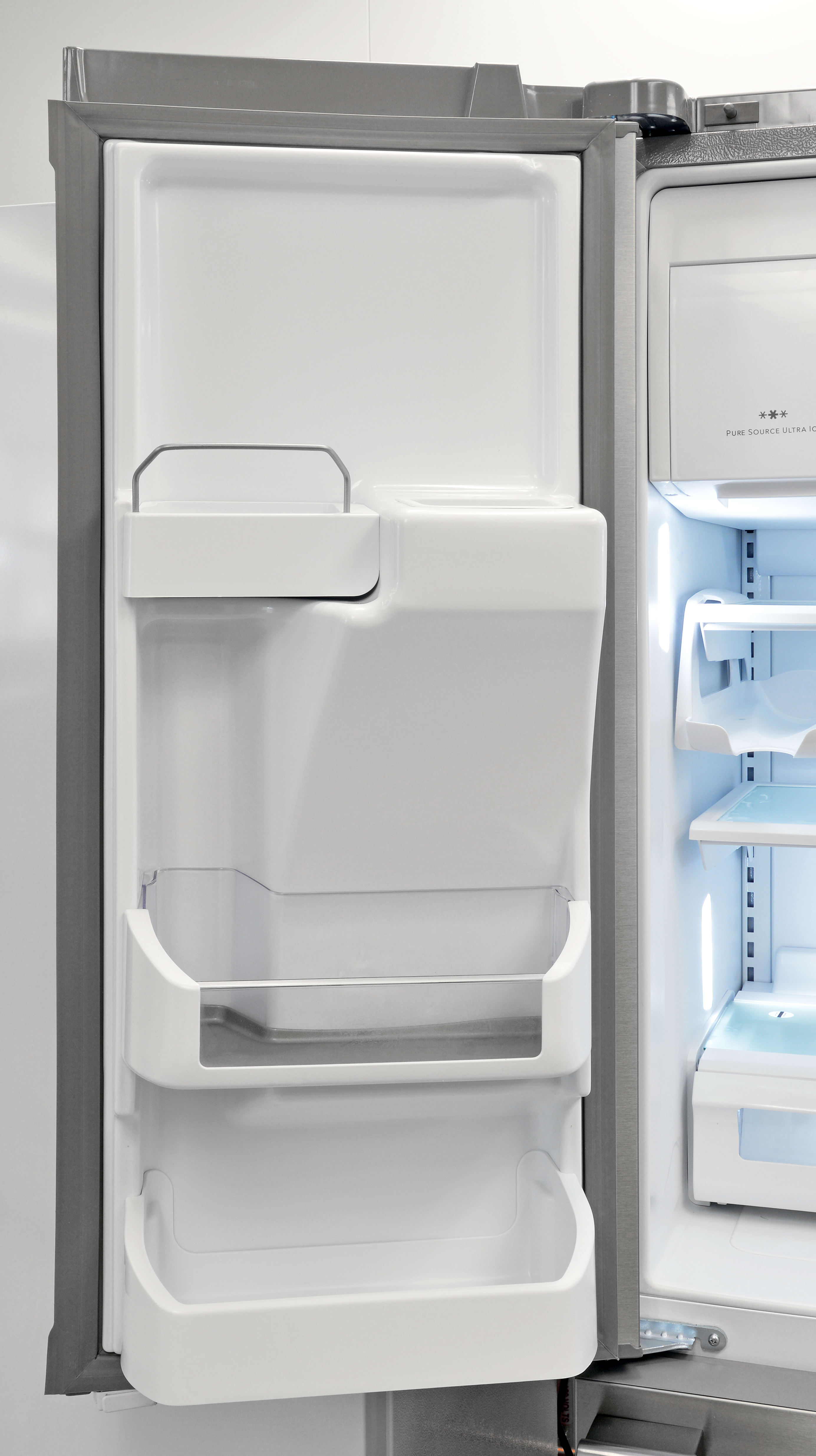 Left-hand shelves are shaped to accommodate the Frigidaire Professional FPBC2277RF's ice dispenser.