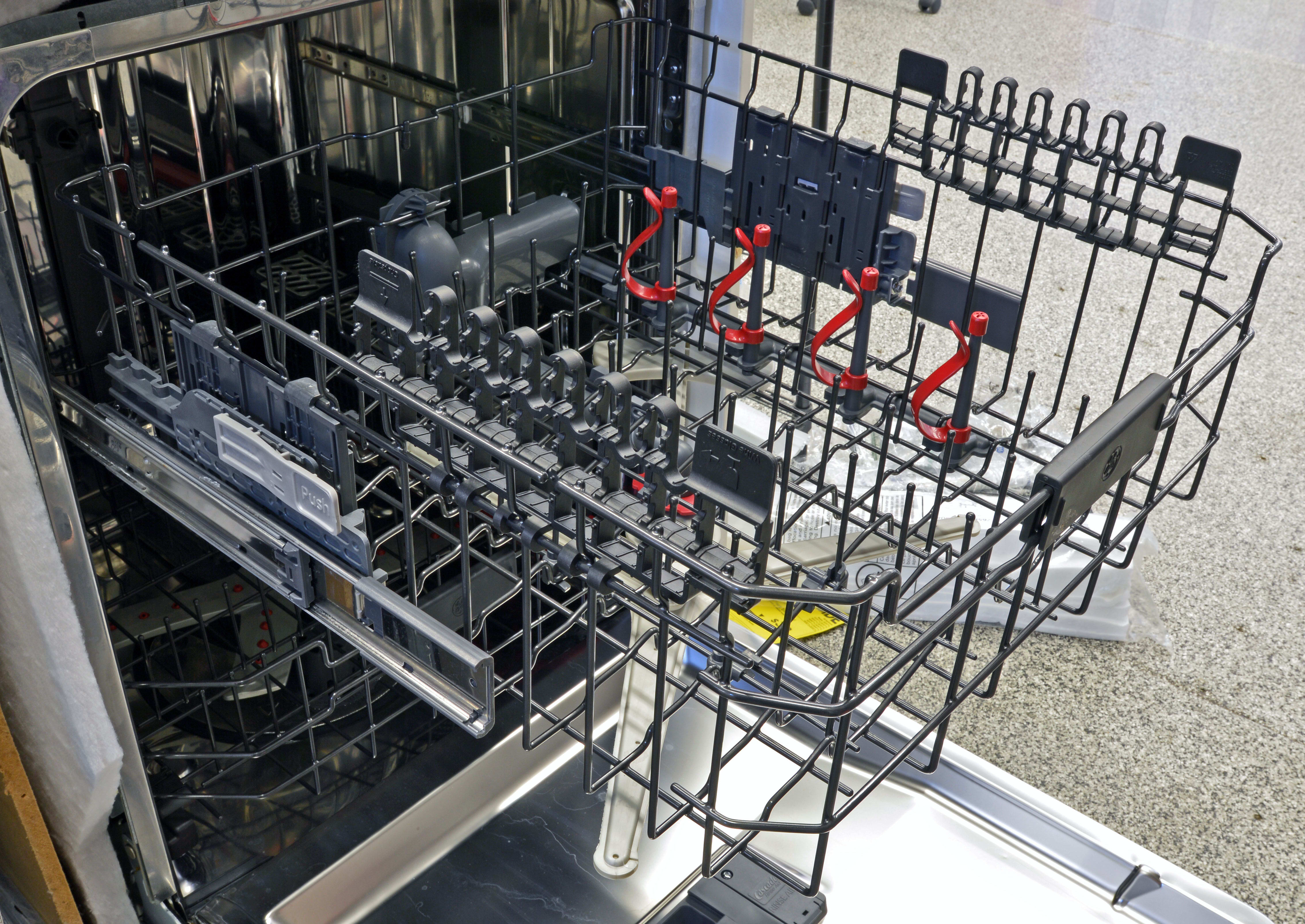 The upper rack features two sets of stemware holders, as well as four bottle jets.