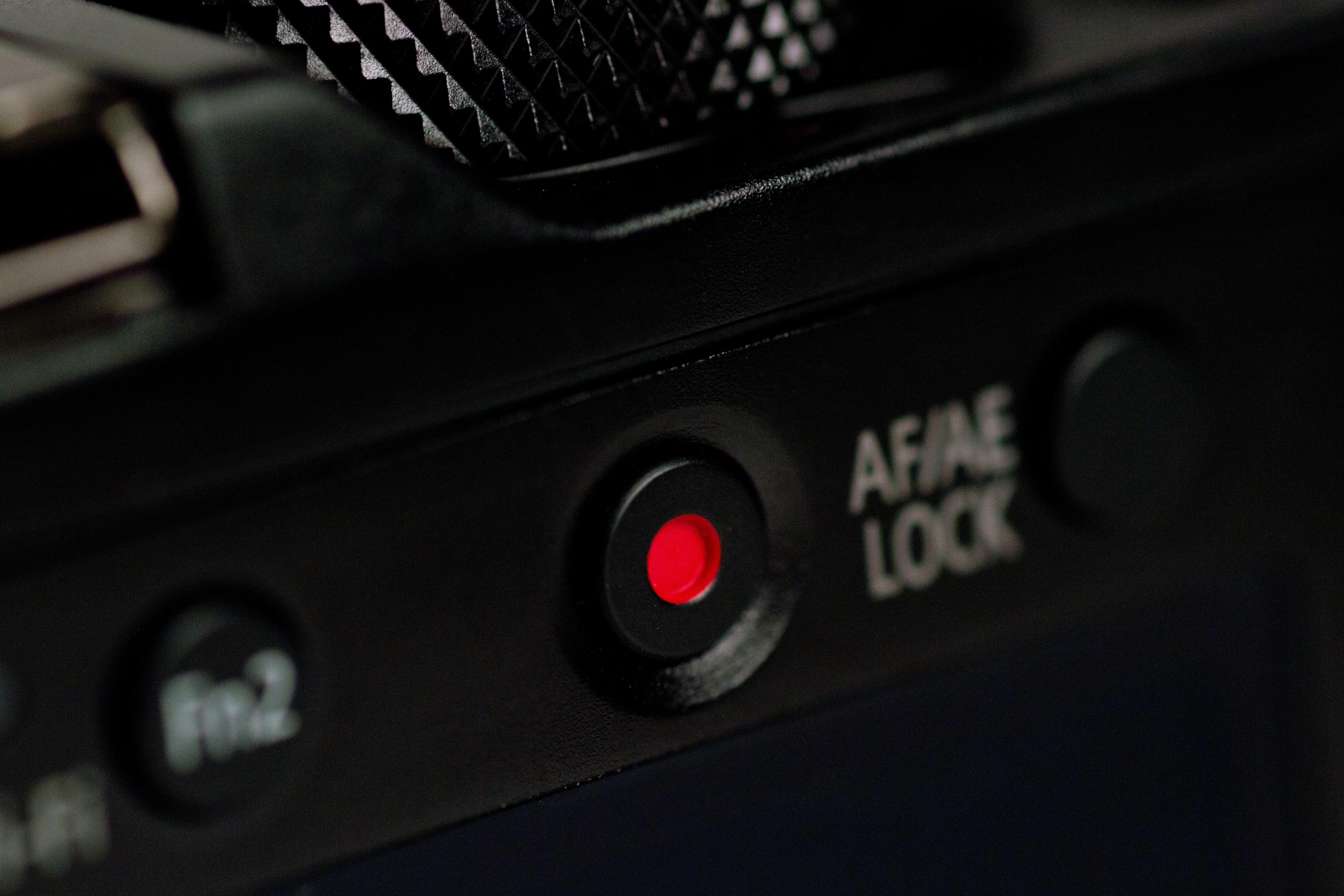 A photograph of the Panasonic Lumix LX100's record button.