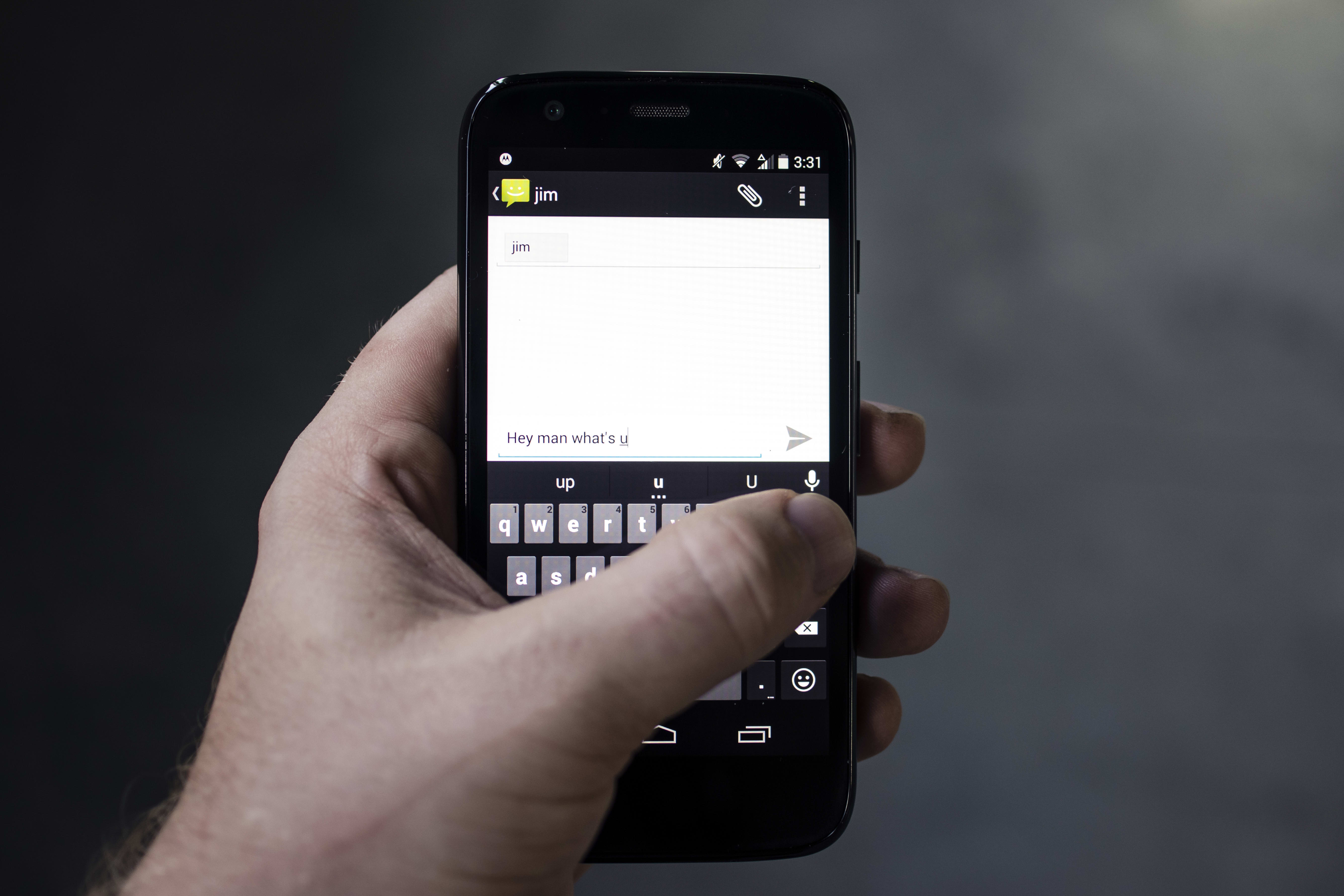 A photo of the Motorola Moto G with 4G LTE's keyboard in use.