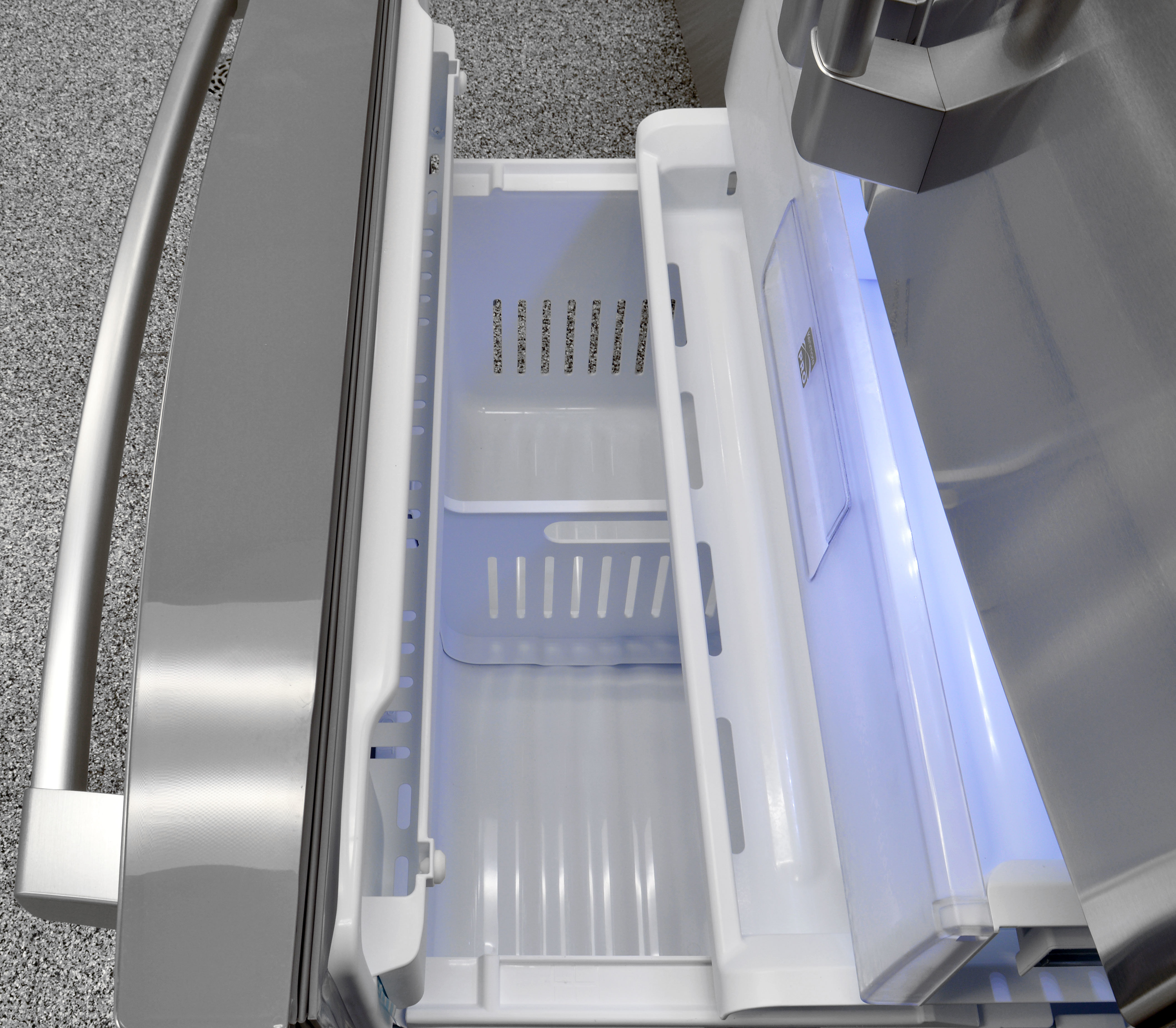 There's a short, shallow shelf just inside the Kenmore Pro 79993's freezer door, useful for keeping track of small or loose items like ice packs.
