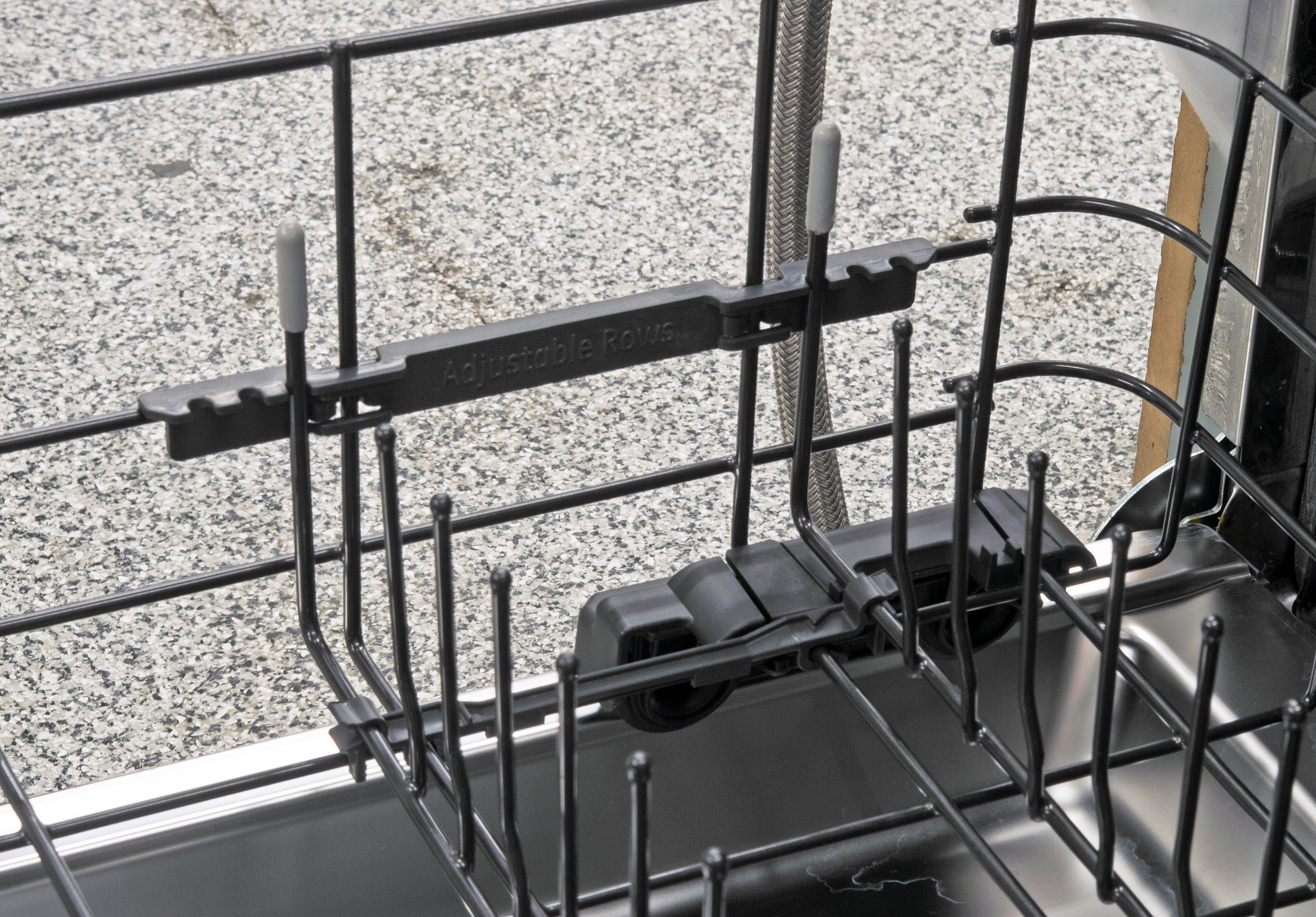 The lower rack has two rows of tines whose width can be adjusted using the mechanism seen here.