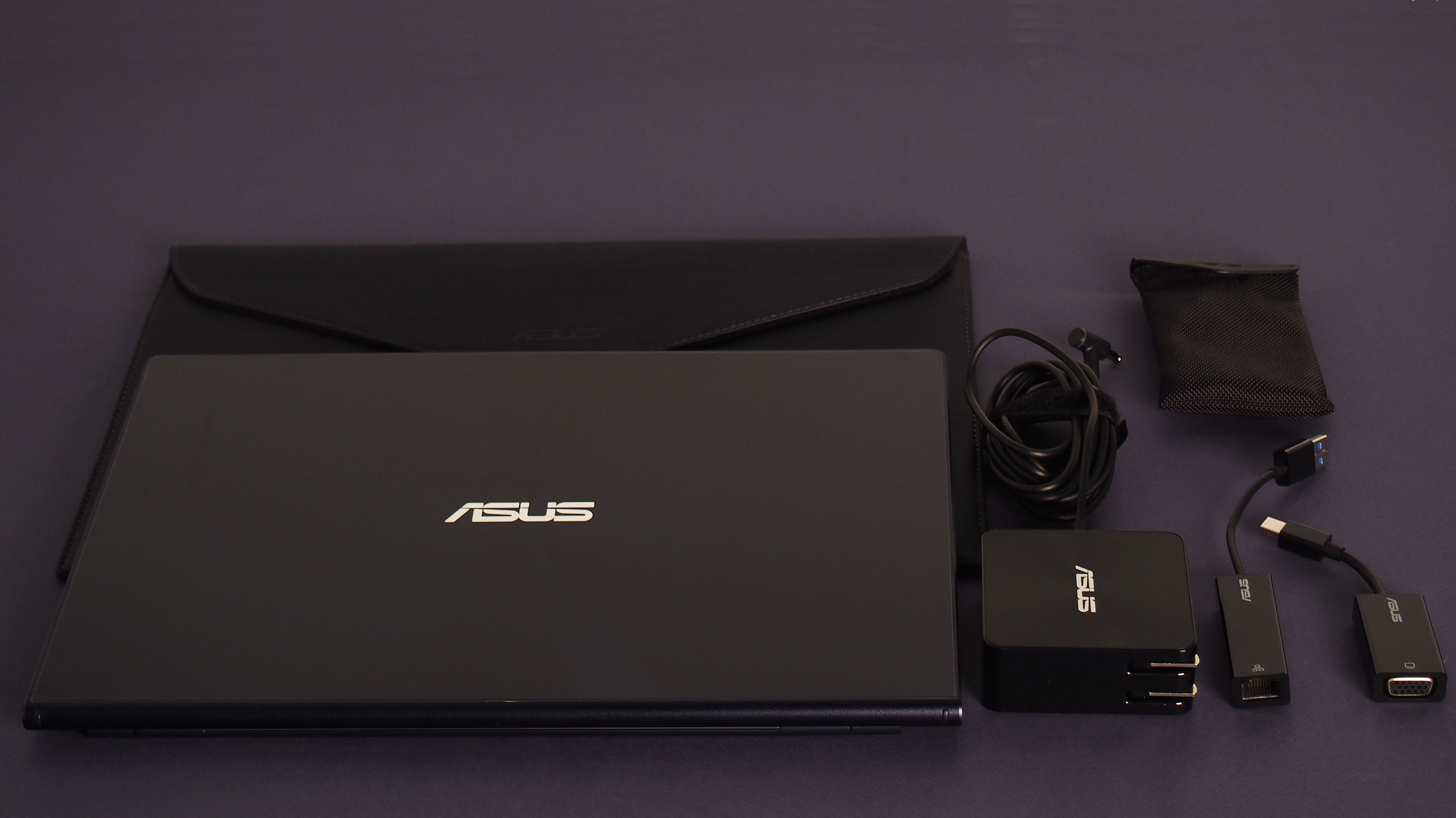 The UX301LA comes with a leather pouch, a charger, a VGA adapter cable, and an ethernet adapter cable.