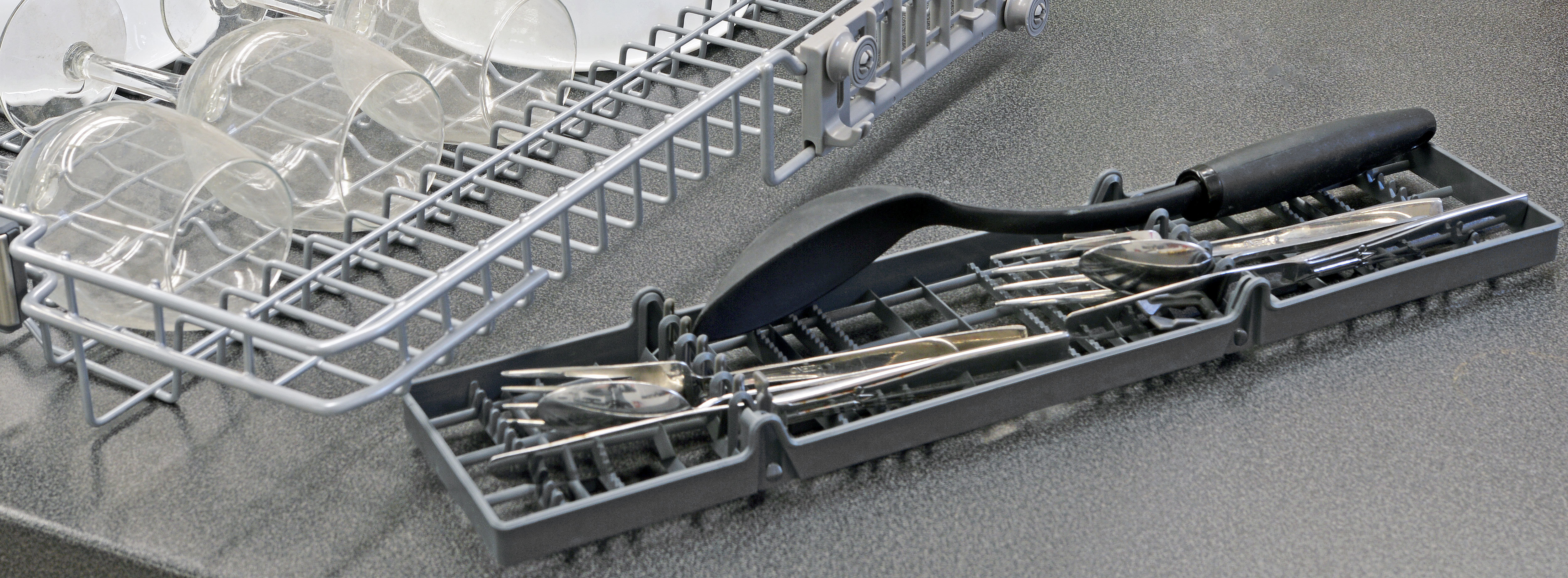 In fact, the silverware tray is a removable piece which also has two rows of folding tines to make it easier for loading large items like spatulas and serving spoons.