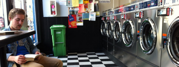 Man at laundromat laundry hero flickr dlytle