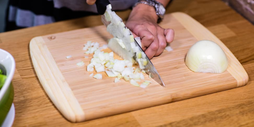 Totally Bamboo Kauai Cutting Board with onions