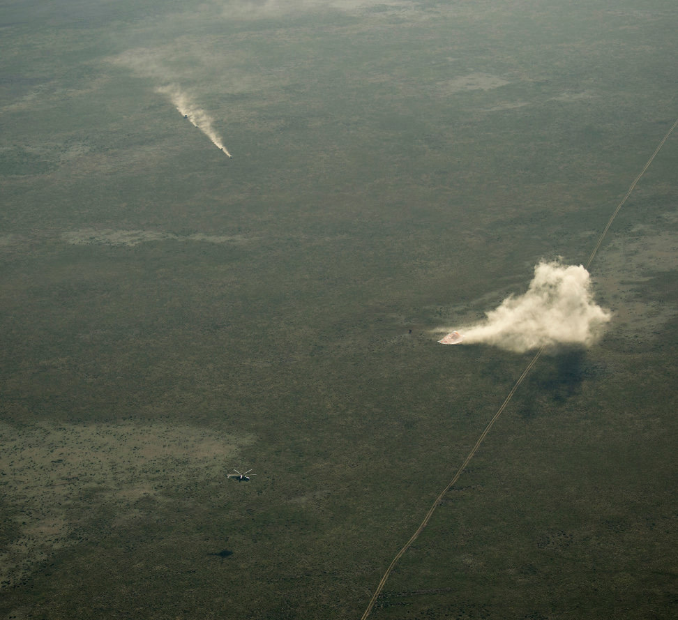 Ground Personnel Race to Soyuz Landing Site.jpg